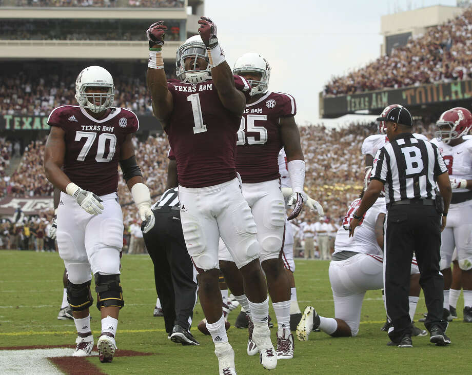Senior running back Ben Malena (middle) has memories good and bad — mostly good of late — of Kyle Field, which will begin to undergo massive renovations after Saturday's game. Photo: Tom Reel / San Antonio Express-News