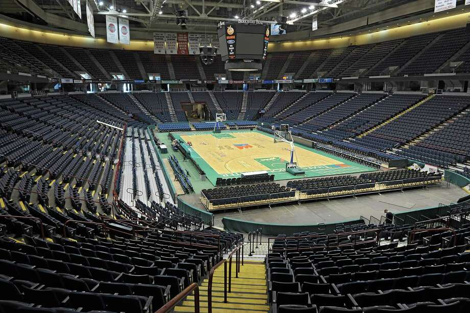 Workers help set up the Times Union Center for the big matchup basketball game Friday night between Siena and UAlbany on Wednesday, Nov. 6, 2013 in Albany, N.Y.  (Lori Van Buren / Times Union) Photo: Lori Van Buren