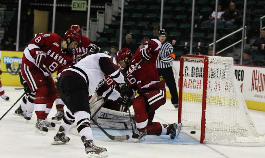 Atlantic City, NJ: ECAC Hockey Mens Championship Game Union (F) #9 Daniel Carr  scores the winning goal in the 3rd period past Harvad Goalie #30 Rahael Girarad. The Union Dutchman beat Harvard 3-1 in the EACA Hockey Championship game in Atlantic City NJ on Saturday 17, 2012 Photo: (Tom Briglia/Special to the Times Union) Photo: Tom Briglia / Times Union