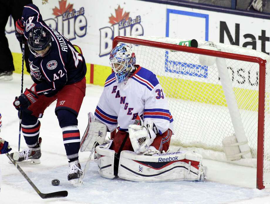 New York Rangers' Cam Talbot, right, makes a save against Columbus Blue Jackets' Artem Anisimov, of Russia, during the third period of an NHL hockey game Thursday, Nov. 7, 2013, in Columbus, Ohio. The Rangers beat the Blue Jackets 4-2. (AP Photo/Jay LaPrete) ORG XMIT: OHJL107 Photo: Jay LaPrete / FR52593 AP