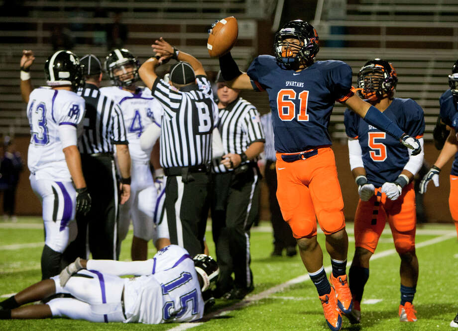 Seven Lakes defensive tackle Ernest Marine celebrates a fumble recovery against Morton Ranch during the fourth quarter of a football game at Rhodes Stadium, Thursday, Nov. 7, 2013, in Katy. Morton Ranch won 28-17. Photo: Cody Duty, Houston Chronicle / © 2013 Houston Chronicle