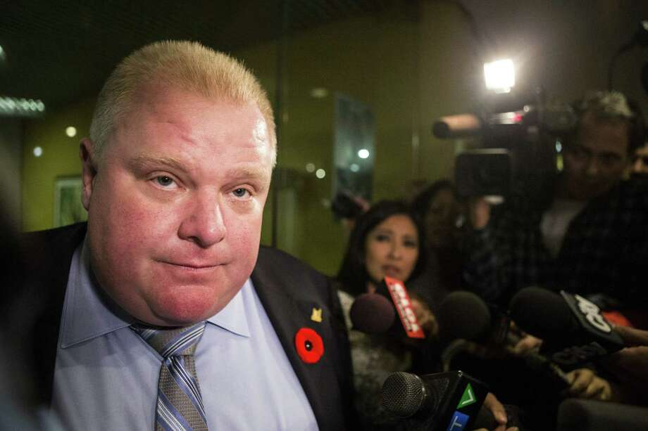 Toronto Mayor Rob Ford makes a statement to the media outside his office at Toronto's City Hall after the release Thursday of his latest embarrassing video. Photo: Chris Young / Associated Press