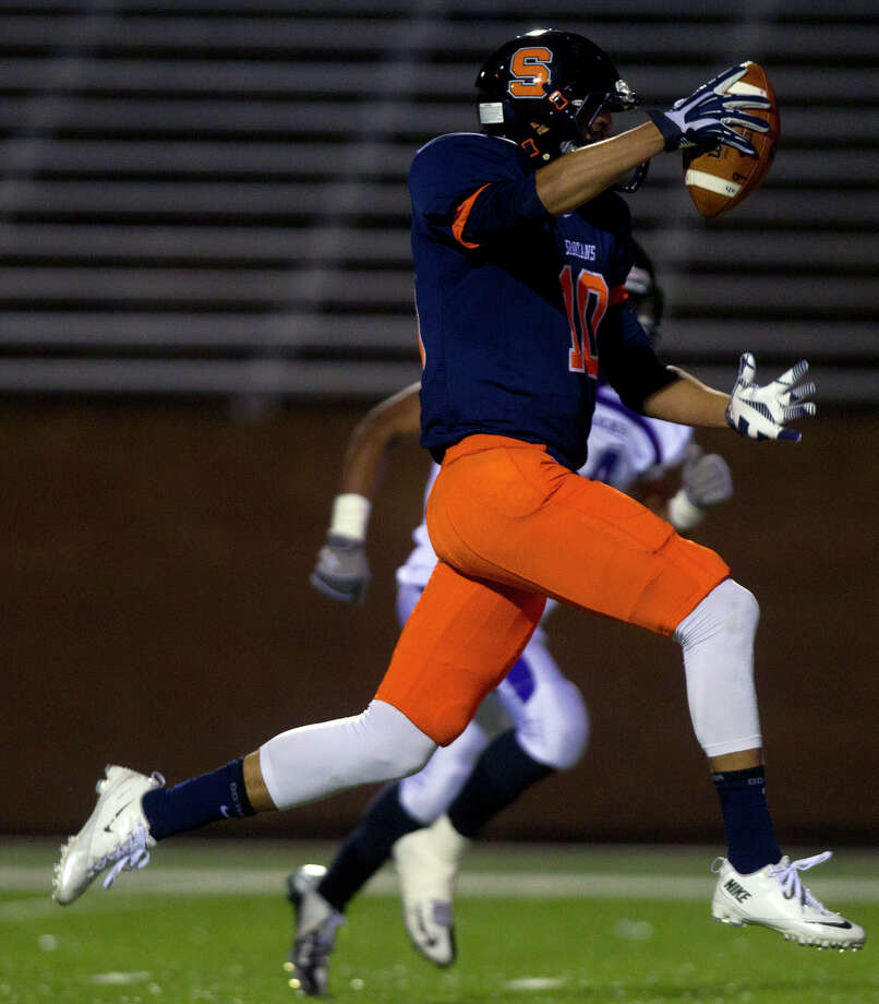 Seven Lakes' Cameron Thomas runs in a touchdown during the fourth quarter of a football game against Morton Ranch at Rhodes Stadium, Thursday, Nov. 7, 2013, in Katy. Morton Ranch won 28-17. Photo: Cody Duty, Houston Chronicle / © 2013 Houston Chronicle