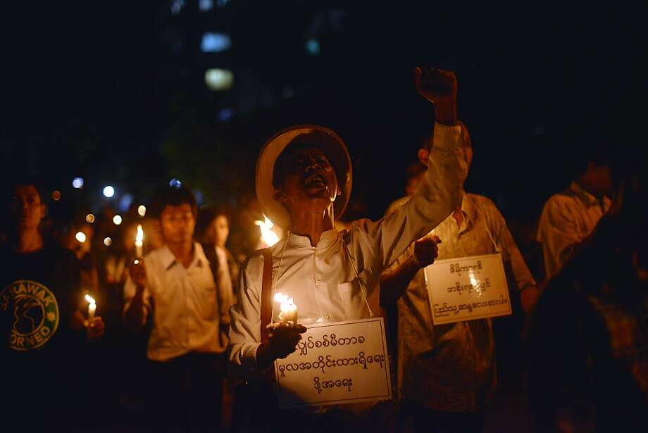 TOPSHOTS Myanmar protesters hold candles and shout slogans as they stage a protest against recent electricity price increases in Yangon on November 7, 2013. AFP PHOTO/Ye Aung ThuYe Aung Thu/AFP/Getty Images Photo: Ye Aung Thu, AFP/Getty Images