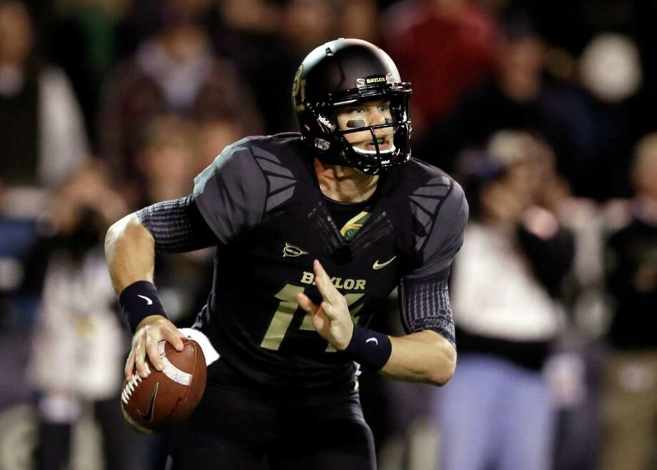 Baylor quarterback Bryce Petty scrambles out of the pocket before passing against Oklahoma in the first half of an NCAA college football game, Thursday, Nov. 7, 2013, in Waco, Texas. (AP Photo/Tony Gutierrez) ORG XMIT: TXTG115 Photo: Tony Gutierrez / AP