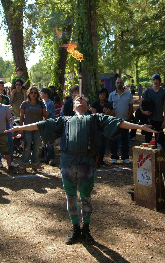 Comedian Jim MacKenzie is one of the dozens of street performers who regularly play the Texas Renaissance Festival. Photo by Joshua Trudell//Special to the Express-News. Photo: JOSHUA TRUDELL, File Photo / SAN ANTONIO EXPRESS-NEWS