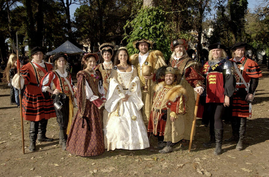 The King and his court at the Texas Renaissance Festival. (From L to R) Ensign Arther (Stephen Morton), Sergeant R. Tankersly (Sarah Miller), Princess Mary (Carla Rodriquez), Queen Isabella (Christiana Carroll), Queen Catherine of Aragon (Rosella Gonzales), King Henry VIII (Greg Taylor), Will Somer (Roger Kercheval), King Ferdinand (Dan Hurley), Thomas Wryth (Ben Hamby) and Captain T. Tankersly (Donn Webb) Photo: BRETT COOMER, File Photo / 2002 Texas Renaissance Festival