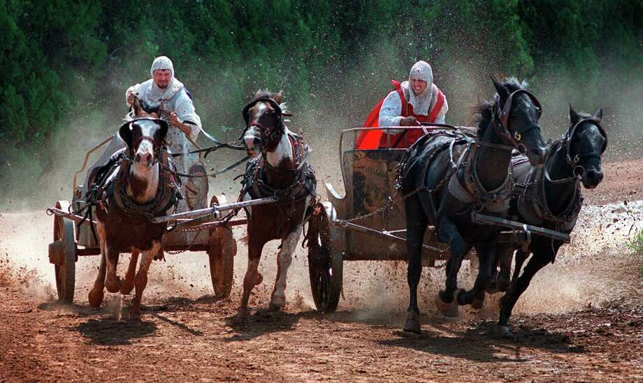 SPORTS/TALL TALES OF TEXAS: Joe Hejl (L) and Jeffrey Shive (rt.) negotiate a muddy curve while battling towards the finish line at the chariot races at the Texas Renaissance Festival on Sunday (Ocober 10). Three races are held each Sunday at the fesival, and each race consists only of one lap. STAFF PHOTO BY: JOHN DAVENPORT Photo: JOHN DAVENPORT, File Photo / EN