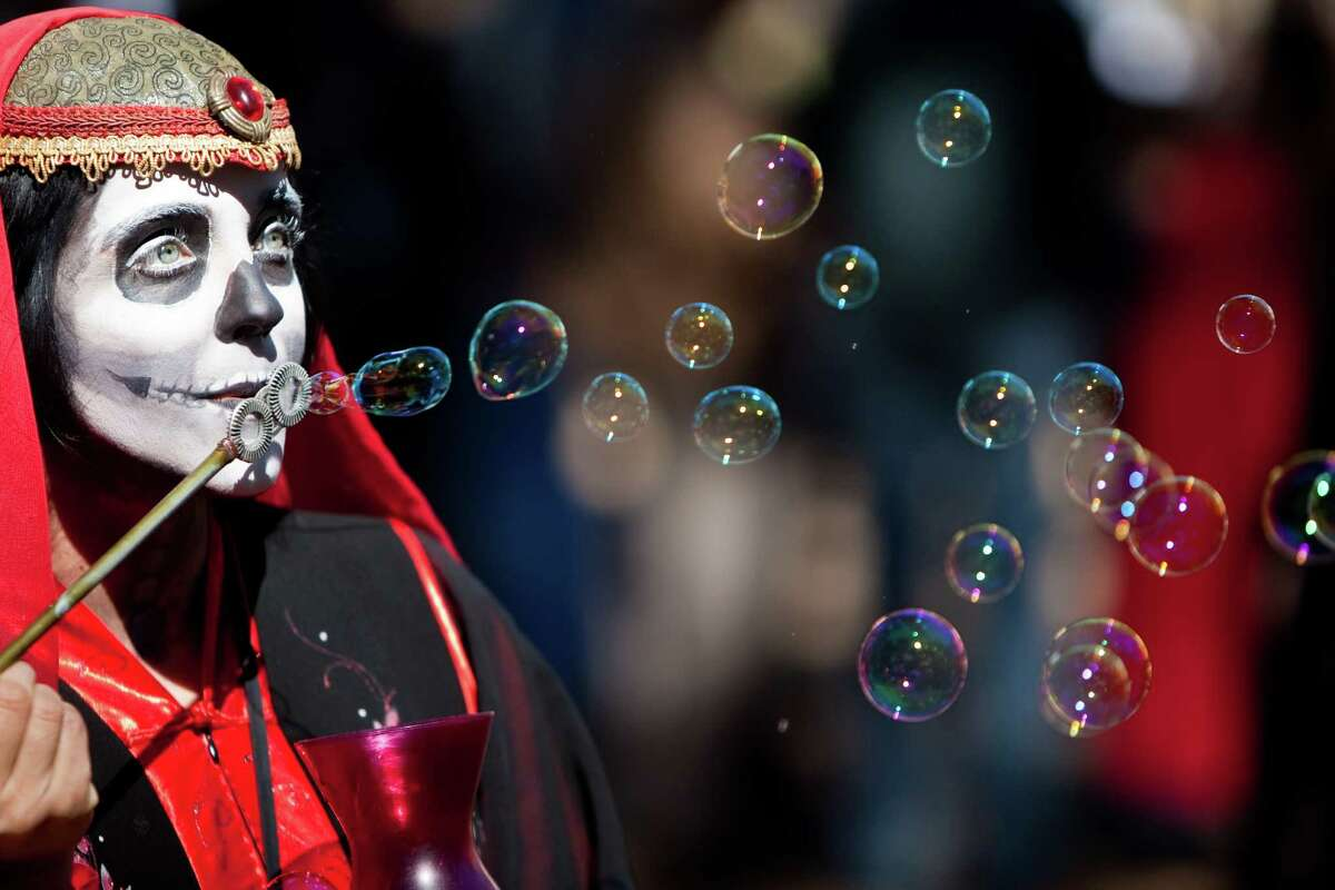 Serendipity Tynker blows bubbles as one of the Texas Renaissance Festival's street walker characters, Sunday, Oct. 28, 2012, in Todd Mission. The festival will continue until November 25th. ( Nick de la Torre / Houston Chronicle )
