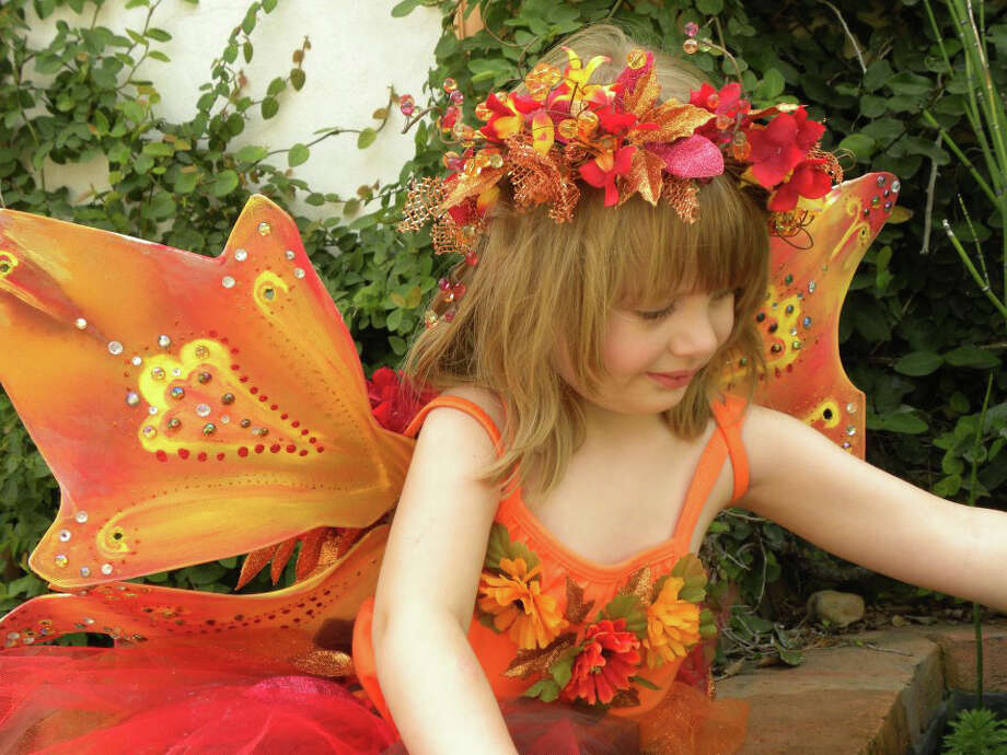 Texas Renaissance Festival fairy girl in fall orange colors Photo: Courtesy Photo, File Photo