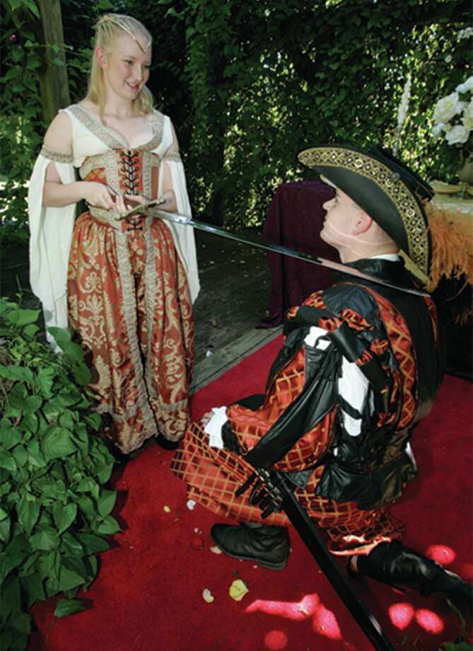 Texas Renaissance Festival, knighting  Knight and lady Photo: Courtesy Photo, File Photo / Texas Renaissance Festival; Knight; lady; sword