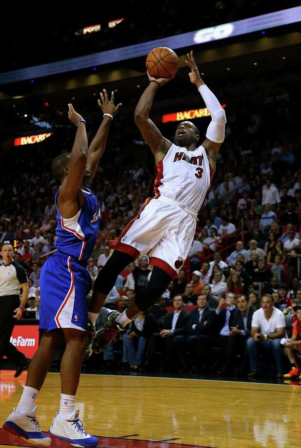 Dwyane Wade, right, turned back the clock on Thursday, leading the Heat in points and assists in a win over Chris Paul and the Clippers. Photo: Mike Ehrmann, Staff / 2013 Getty Images