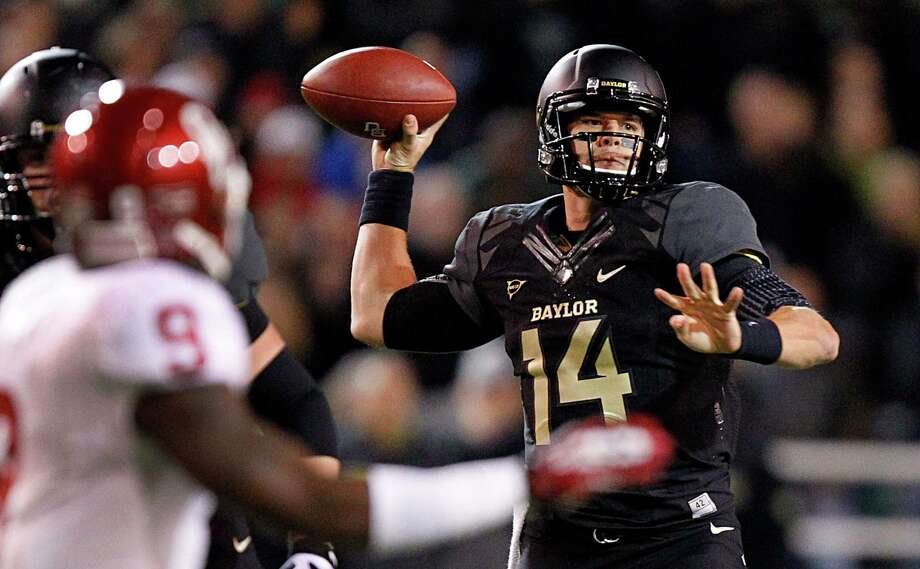 Bryce Petty's second-quarter touchdown pass was one of three thrown by the Baylor quarterback. He also ran for two scores. Photo: Tom Fox, MBR / The Dallas Morning News