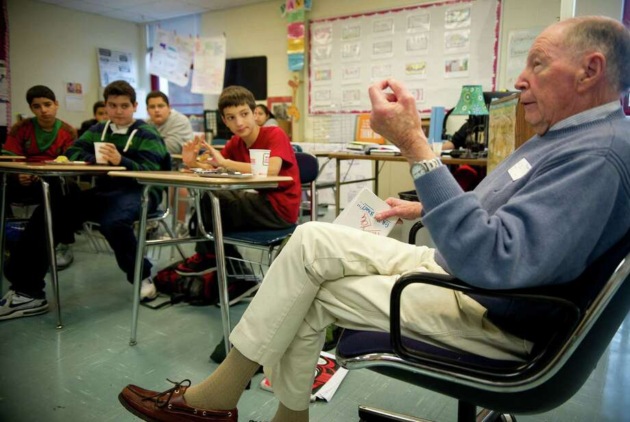 Navy veteran John Nolan speaks to an eighth-grade class at Turn of River Middle School in Stamford on Thursday during their Veterans Day breakfast. Photo: Lindsay Perry / Stamford Advocate