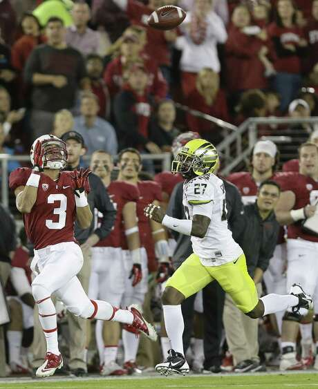 Stanford receiver Michael Rector (left) catches a pass in front of Oregon's Terrance Mitchell. Photo: Marcio Jose Sanchez / Associated Press