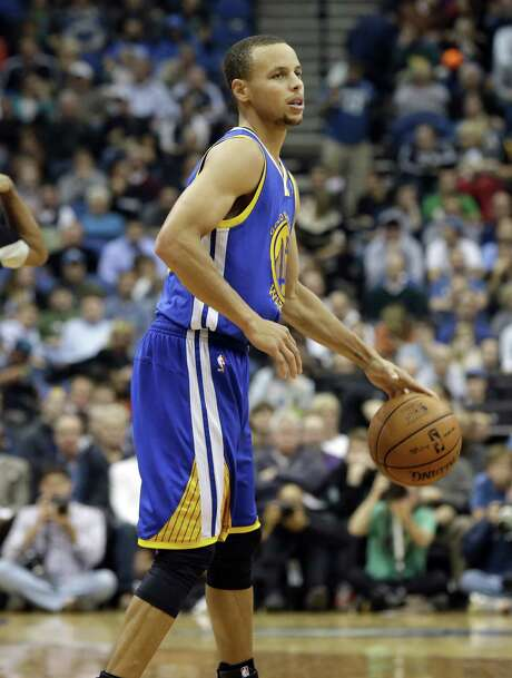Steph Curry injured his left ankle Wednesday, but the Warriors' sharpshooter promised he'll play today. Photo: Jim Mone / Associated Press