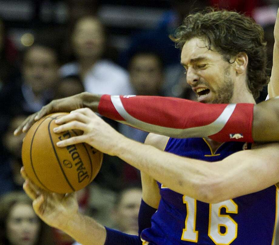 Lakers center Pau Gasol (16) grabs a rebound as Rockets center Dwight Howard (12) reaches in. Photo: Brett Coomer, Houston Chronicle