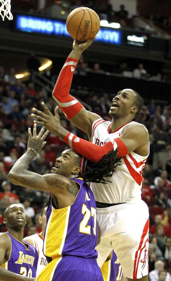 Rockets center Dwight Howard (12) drives to the basket over Lakers center Jordan Hill (27). Photo: Brett Coomer, Houston Chronicle