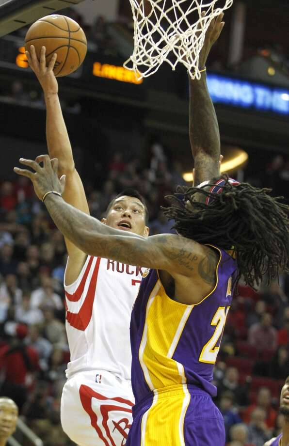 Rockets point guard Jeremy Lin (7) shoots a layup over Lakers center Jordan Hill (27). Photo: Brett Coomer, Houston Chronicle
