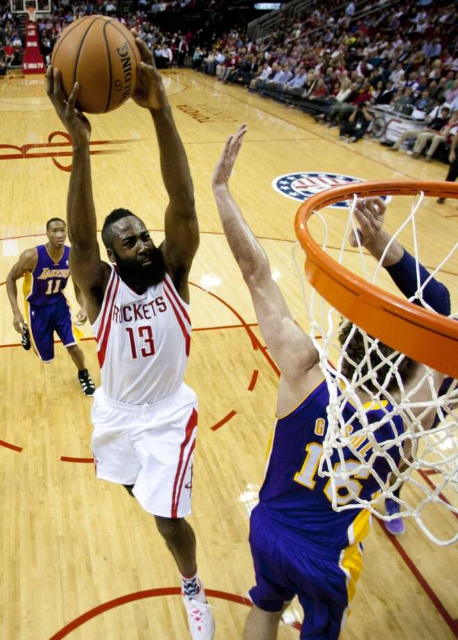 Rockets shooting guard James Harden (13) drives to the basket over Lakers center Pau Gasol (16). Photo: Brett Coomer, Houston Chronicle