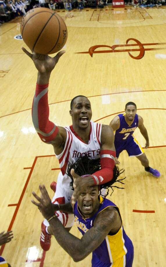 Rockets center Dwight Howard (12) shoots over Lakers center Jordan Hill (27). Photo: Brett Coomer, Houston Chronicle