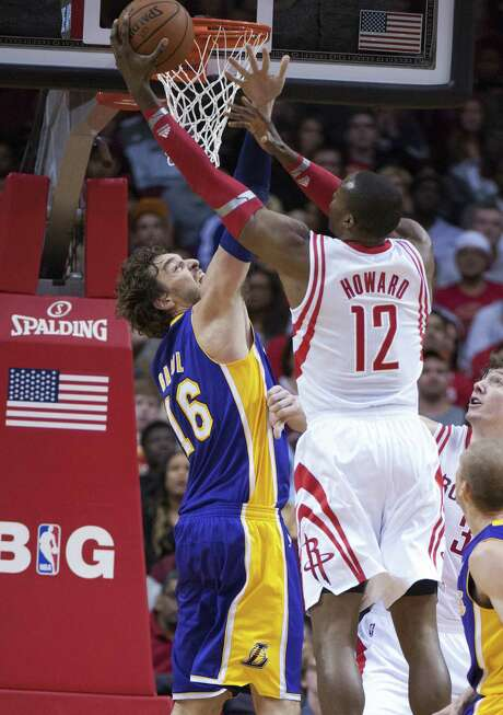 Rockets center Dwight Howard shoots over former Lakers teammate Pau Gasol in Houston. Photo: George Bridges / McClatchy-Tribune