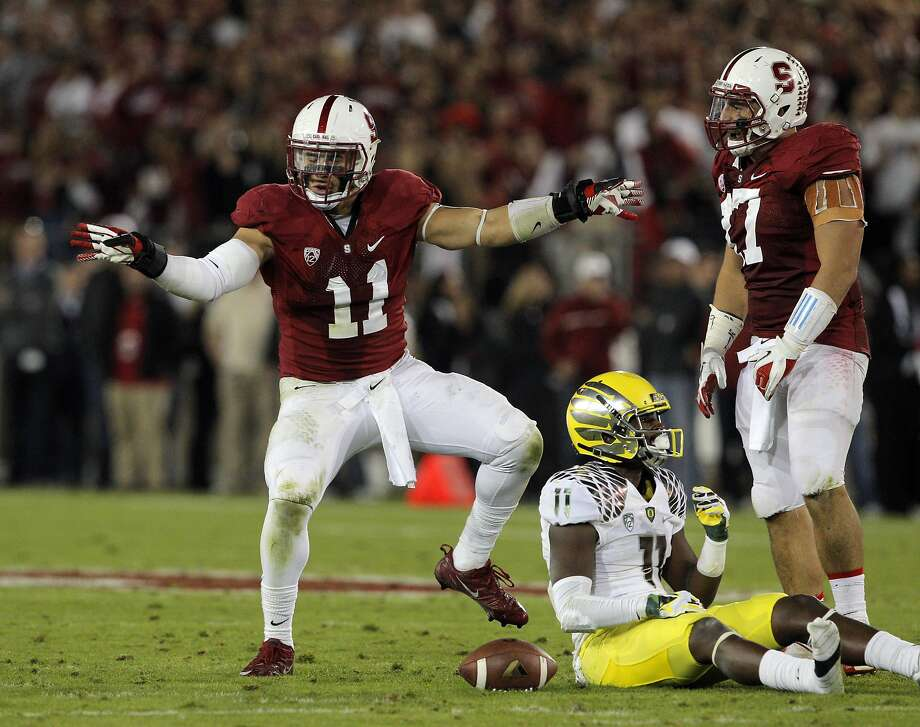Shayne Skov (11) celebrates after breaking up a pass intended for Bralon Addison (11) in the third quarter. The Stanford Cardinal played the Oregon Ducks at Stanford Stadium in Stanford, Calif., on Thursday, November 7, 2013. Stanford defeated the Ducks 26-20. Photo: Carlos Avila Gonzalez, The Chronicle