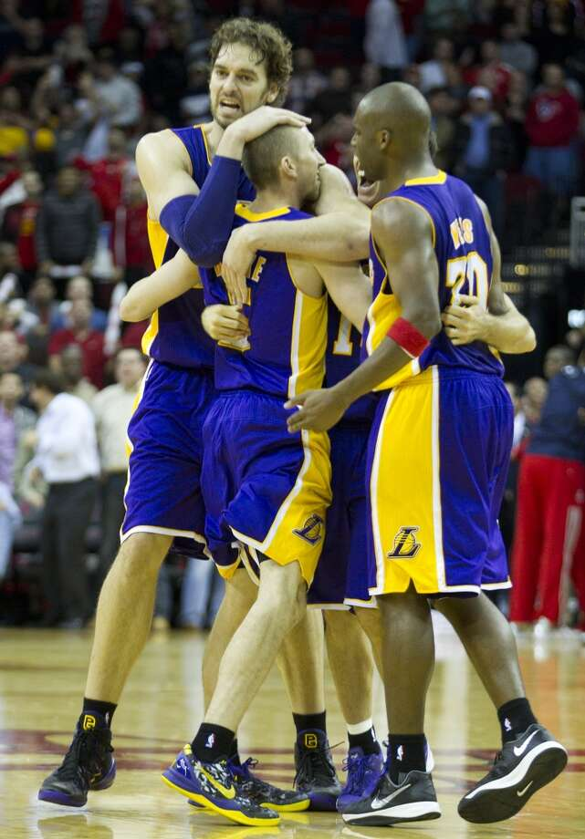 Nov. 7: Lakers 99, Rockets 98   Lakers point guard Steve Blake (5) is embraced by his teammates after he hit a 3-pointer with less than 2 seconds left to beat the Rockets. Photo: Brett Coomer, Houston Chronicle