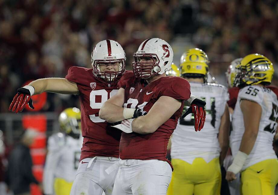 Henry Anderson (right) celebrates with Trent Murphy after sacking Oregon's Marcus Mariota last week. Photo: Carlos Avila Gonzalez, The Chronicle