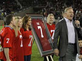 Former Stanford quarterback John Elway addresses the crowd with his family as his No. 7 jersey is retired at halftime of the game between the Cardinal and Oregon Ducks on Thursday. The Stanford Cardinal played the Oregon Ducks at Stanford Stadium in Stanford, Calif., on Thursday, November 7, 2013. Stanford defeated the Ducks 26-20.