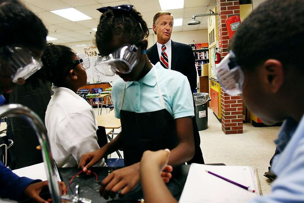 Tennessee Gov. Bill Haslam compliments a group of 6th graders at John P. Freeman Optional School in Memphis, Tenn. Thursday, Nov. 7, 2013, after the State of Tennessee scored high on National Assessment of Educational Progress Tests, marking the best educational gains in any state. The students were at work learning about electrical current. (AP Photo/The Commercial Appeal, Kyle Kurlick)