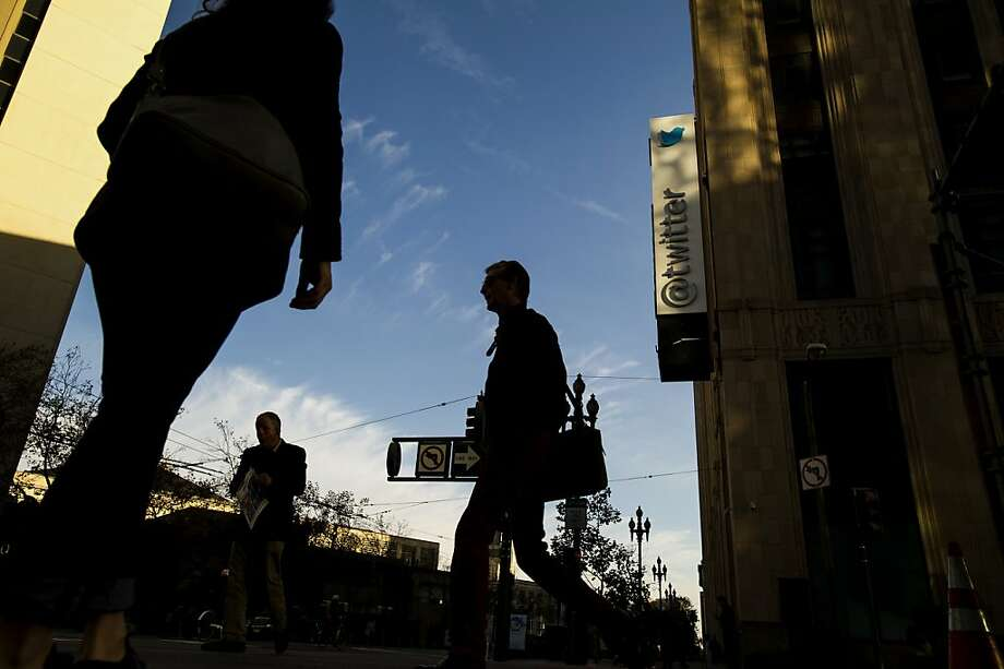 Pedestrians walk in front of the Twitter Inc. headquarters in San Francisco, California, U.S., on Thursday, Nov. 7, 2013. Twitter Inc. surged 85 percent in its trading debut, as investors paid a premium for its promises of fast growth. Photographer: David Paul Morris/Bloomberg Photo: David Paul Morris, Bloomberg