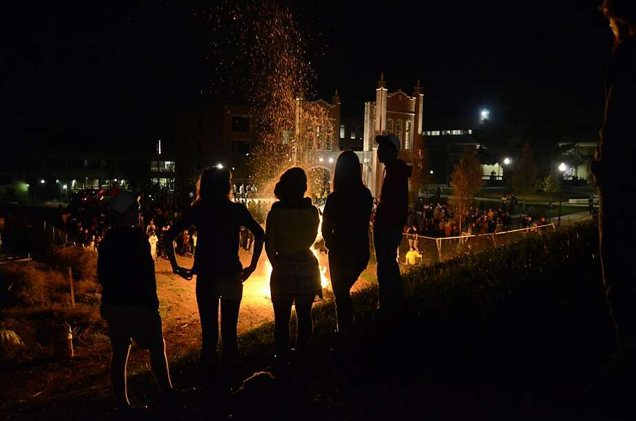 Students watch a bonfire Wednesday Nov. 6, 2013 at at the University of Tennessee at Chattanooga. (AP Photo/Chattanooga Times Free Press, Angela Lewis) Photo: Angela Lewis, Associated Press