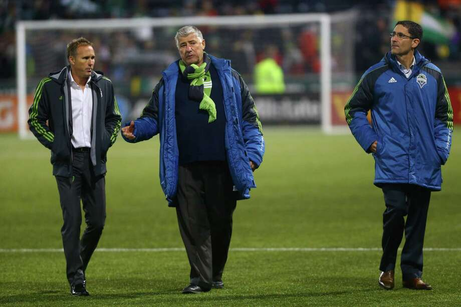 Seattle Sounders sporting director Chris Henderson, coach Sigi Schmid and owner Adrian Hanauer walk off the field after the Sounders were defeated by the Portland Timbers in an MLS Playoff match at JELD-WEN Field in Portland on Thursday, November 7, 2013. The Timbers defeated the Sounders, ending the season for Seattle. Photo: JOSHUA TRUJILLO, SEATTLEPI.COM / SEATTLEPI.COM