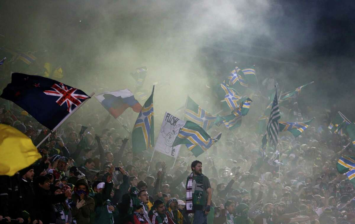 Smoke rises from the Portland Timbers Army as the clock winds down during an MLS Playoff match against the Sounders at JELD-WEN Field in Portland on Thursday, November 7, 2013. The Timbers defeated the Sounders, ending the season for Seattle.