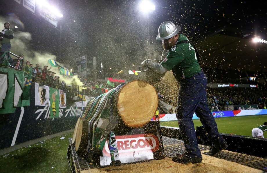 Portland Timbers mascot Timber Jim cuts a log after a goal against the Seattle Sounders during an MLS Playoff match at JELD-WEN Field in Portland on Thursday, November 7, 2013. The Timbers defeated the Sounders, ending the season for Seattle. Photo: JOSHUA TRUJILLO, SEATTLEPI.COM / SEATTLEPI.COM