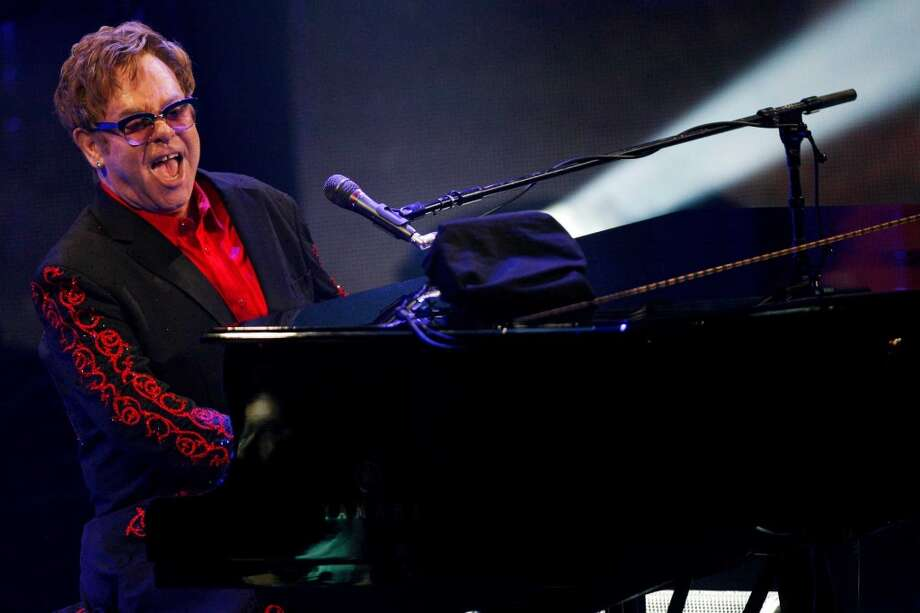 Elton John performs at the Roundhouse in London as part of the iTunes Festival, Thursday, Sept. 12, 2013. (Photo by Jim Ross/Invision/AP) ORG XMIT: LDN102 Photo: Jim Ross, AP