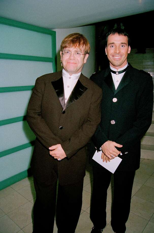 British Singer Elton John with his partner David Furnish at the 10th Anniversary party for the jeweller Tiffany's at Tiffany's Bond Street store, London, 2nd October 1996. (Photo by Dave Benett/Getty Images) Photo: Dave Benett, Getty Images / 2008 Getty Images