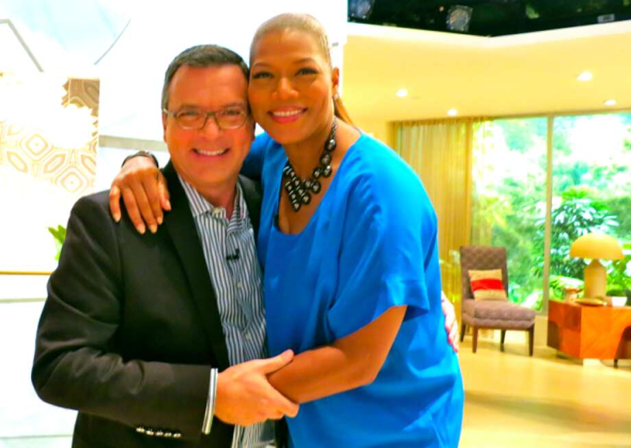 Chris McGinnis and Queen Latifah on the Queen Latifah Show set in Los Angeles for a spot on Holiday Travel advice