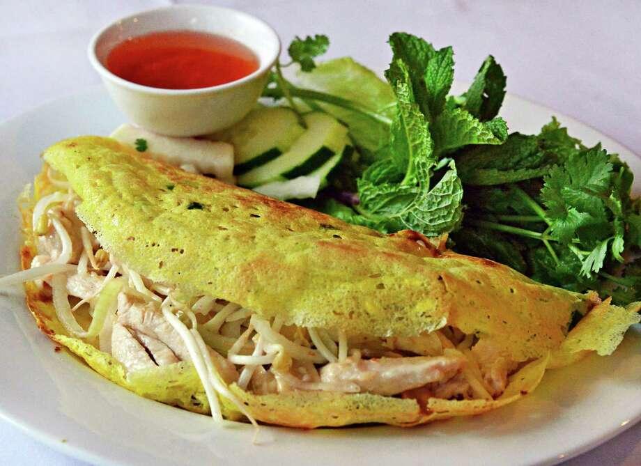 Kim's Vietnamese Restaurant. 791 Madison Ave., Albany.Vietnamese crispy chicken pancake at Kim's Vietnamese restaurant on Madison Ave. Thursday Oct. 31, 2013, in Albany, NY. (John Carl D'Annibale / Times Union) Photo: John Carl D'Annibale / 00024459A