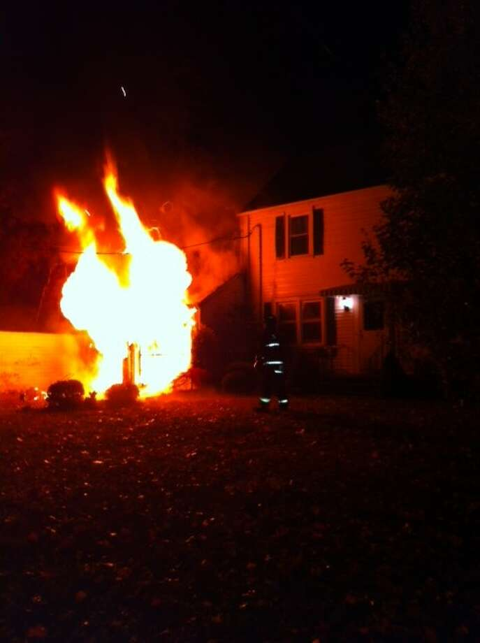 Stratford firefighters battled an early morning garage fire at 43 East Laughlin Road on Friday, Nov. 8, 2013. They were able to stop the fire from spreading to the house. There were no injuries. Photo: Stratford Fire Department / Connecticut Post