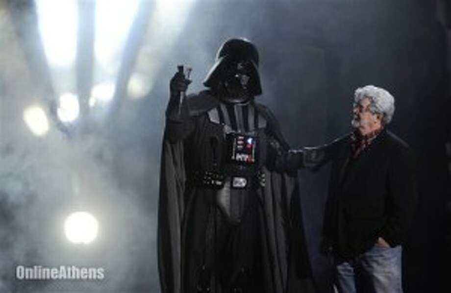 George Lucas and Darth Vader in the making of one of the 'Star Wars' films. Photo by Associated Press.