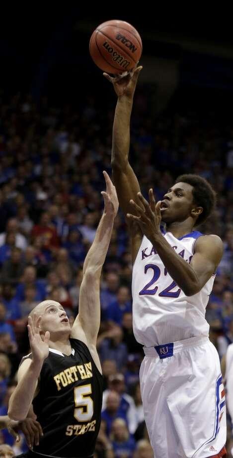 Andrew Wiggins  Position: Small forward  School: Kansas  Class: Freshman Photo: Charlie Riedel, Associated Press