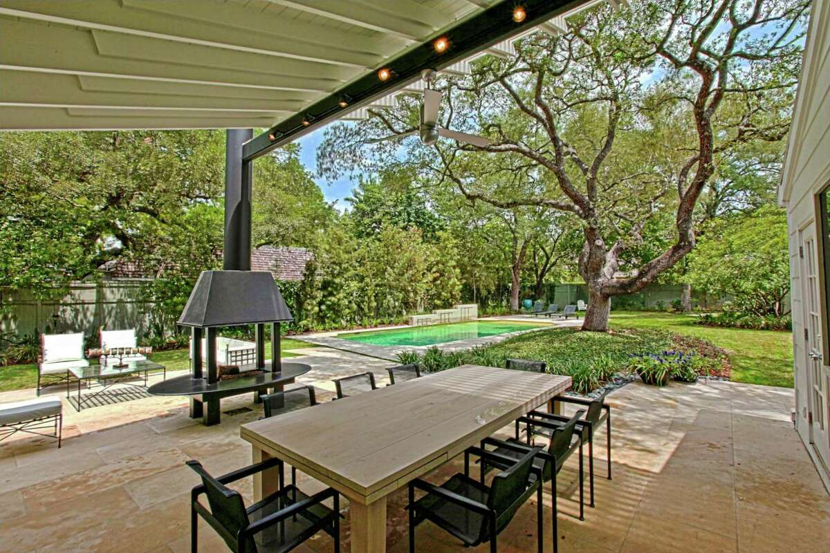 Outdoor living spaces include a little of everything from the indoors: comfortable seating, fireplaces, sinks and grills.