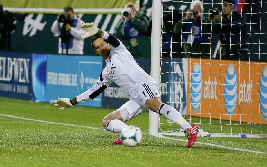 Seattle Sounders goalkeeper Michael Gspurning, can't get to a penalty kick goal kicked by Portland Timbers' Will Johnson in the first half of the second game of the Western Conference semifinals in the MLS Cup soccer playoffs, Thursday, Nov. 7, 2013, in Portland, Ore. Photo: Ted S. Warren, AP / AP