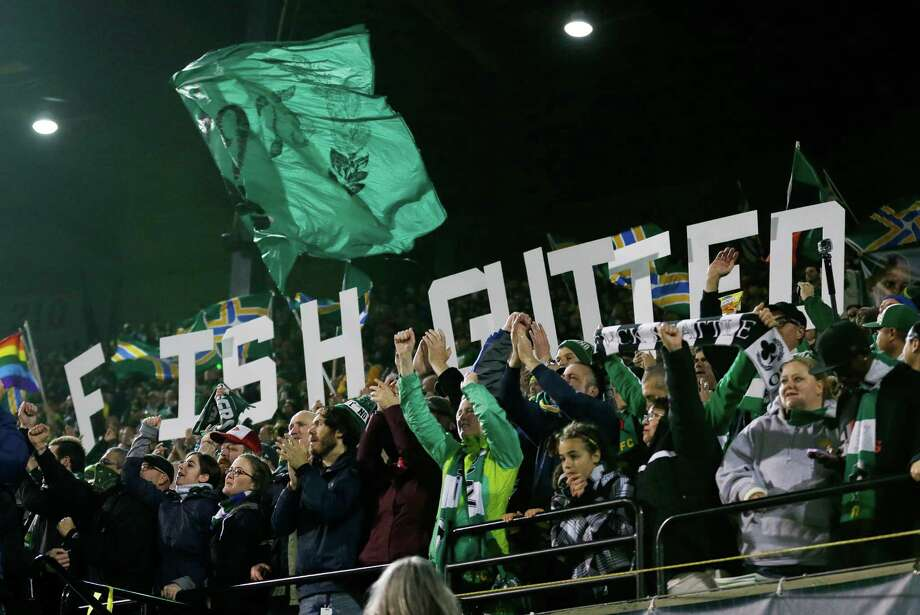 "Portland Timbers supporters spell out ""Fish Gutted"" in reference to their nickname of ""Flounders"" for the Seattle Sounders after the Timbers beat the Sounders 3-2 in the second half of the second game of the Western Conference semifinals in the MLS Cup soccer playoffs, Thursday, Nov. 7, 2013, in Portland, Ore. The win gave the Timbers a 5-3 aggregate score in the two-match series. The Timbers will advance to the Western Conference semifinals against Real Salt Lake. Photo: Ted S. Warren, AP / AP"