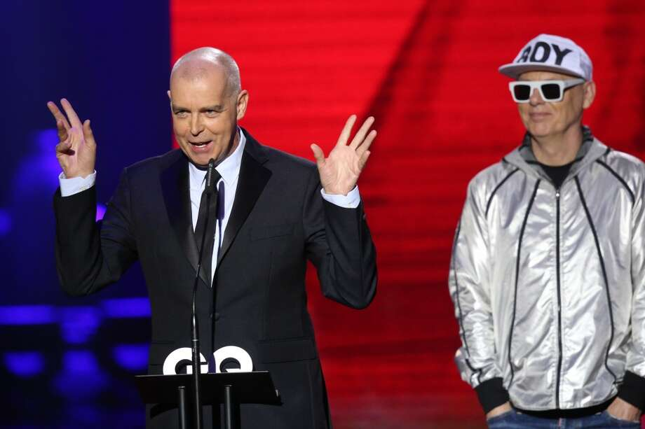 The members of the band 'Pet Shop Boys' Neil Tennant (L) and Chris Lowe receive an award on stage at the GQ Men Of The Year Award at Komische Oper on November 7, 2013 in Berlin, Germany.  (Photo by Sean Gallup/Getty Images  for GQ) Photo: Sean Gallup