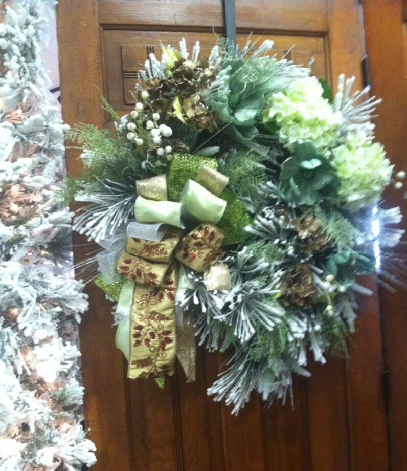Soft green is popular in holiday wreaths and other décor, according to Cornelius Nursery designers.