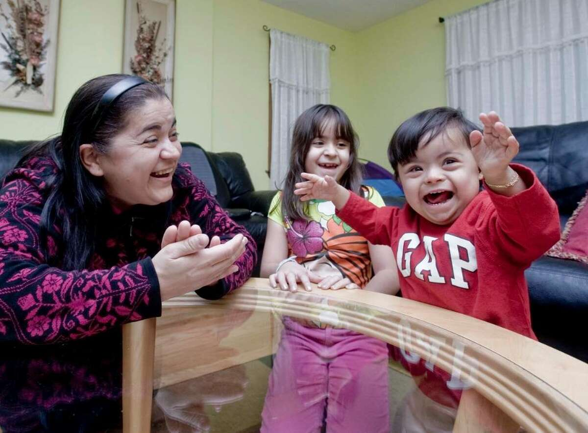 Elaine Ferreira plays with daughter Deborah, 7 and son Philip, 2 at their home in Danbury. Philip has Down syndrome. Thursday, Jan. 21, 2010