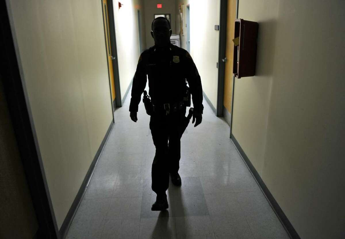 Sgt. Charles Johnson walks down the hallway at the West Side Precinct in Bridgeport, Conn. on Thursday January 28, 2010. Johnson is a new supervisor in the police department's SET team. He survived a head-on crash while on duty a year ago, and brings what he learned through the crash and recovery to his work now.